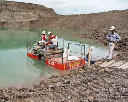 Portable floating reagent mixing and dosing equipment being used for treating turbidity at coal mine in Indonesia.