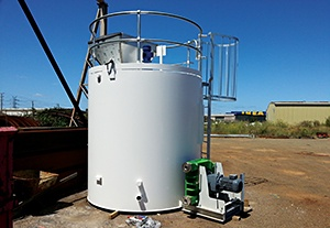 Vertical mixing tank at mine site for mixing and dosing reagents.